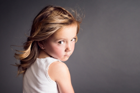 Portrait of a Young Girl Looking Over Her Shoulder, Not Smiling - Classic Kids Photography