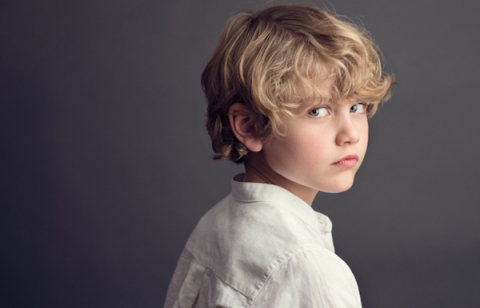 Portrait of a Young Boy in a White Shirt Giving a Meaningful Look, Not Smiling - Classic Kids Photography